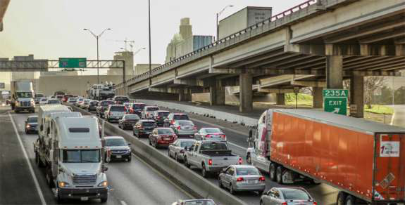 Several semi trucks in commuter traffic