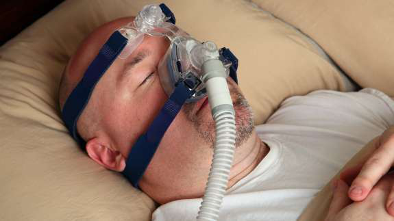 Man with CPAP mask sleeping