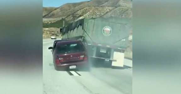 Car being dragged behind truck