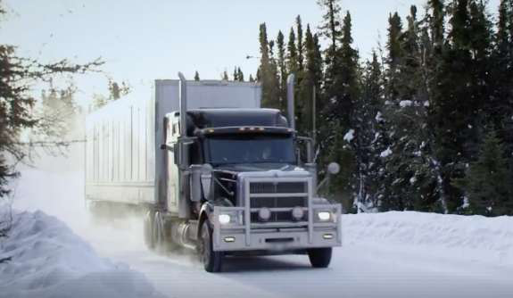 semi truck driving on a snowy road