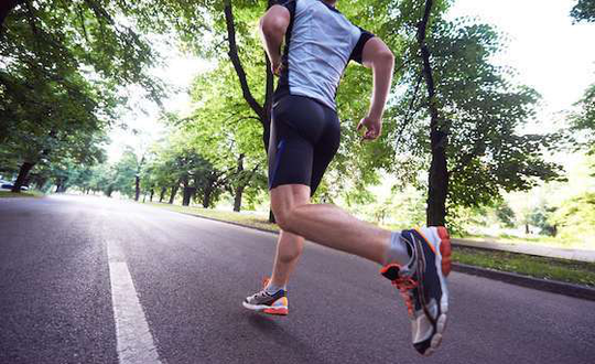A Man Jogging on the Road