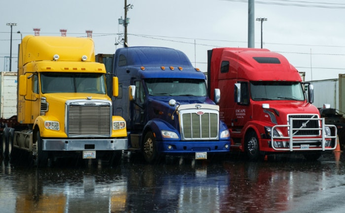 trucks-idle-in-rain