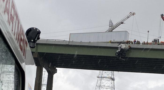 tractor-trailer-hangs-off-bridge