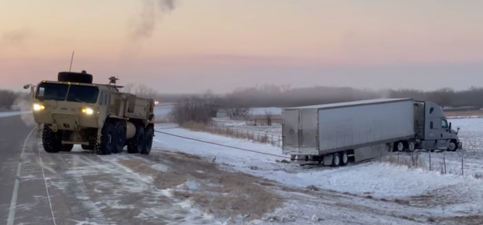 National Guard troops used heavy equipment to rescue tractor-trailers that had trouble in the winter weather conditions in Oklahoma Monday.