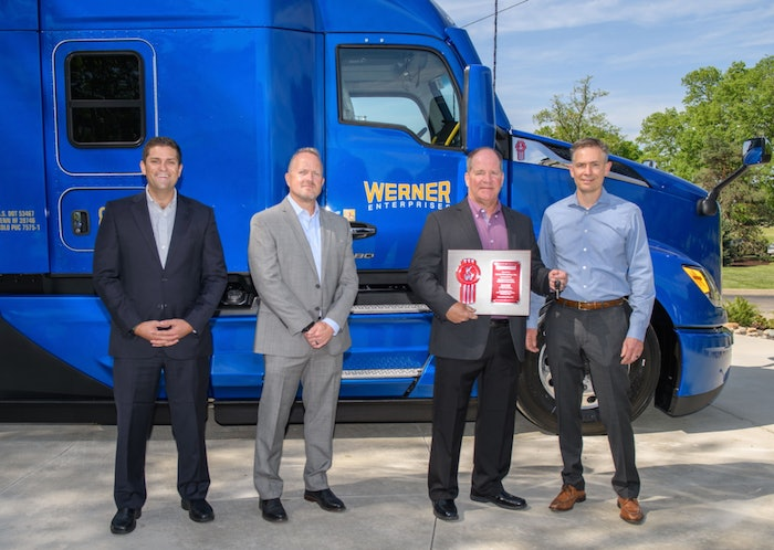 At far right, Kevin Baney, Kenworth general manager and PACCAR vice president, presents the keys – and a plaque signifying the delivery of the first production T680 Next Gen – to Scott Reed, Werner Enterprises senior vice president of equipment purchasing and maintenance. From far left are Corey Murphy, vice president of MHC Kenworth Iowa/Nebraska/Illinois, representing selling dealer MHC Kenworth – Omaha; and Tony Wahl, Werner Enterprises director of equipment purchasing.